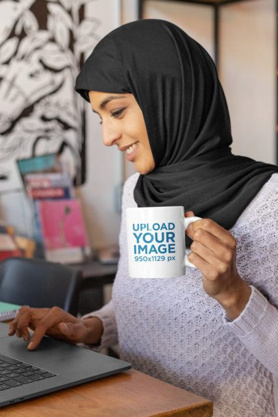 11 oz Coffee Mug Mockup Featuring a Young Woman Working on Her Computer 32393