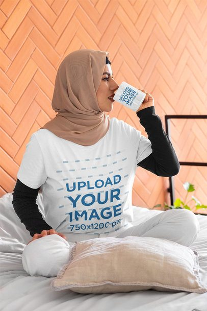 T-Shirt Mockup Featuring a Woman at Her Home Drinking Coffee from an 11 oz Mug 32398