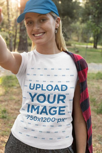 T-Shirt Mockup Featuring a Woman Taking a Selfie in the Forest 32245