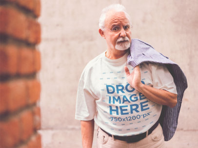 T-Shirt Mockup of a Senior Man with a Jacket Over his Shoulder a12386
