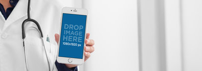 iPhone Mockup Featuring a Doctor Holding an iPhone 6 in Frontal View a12308b