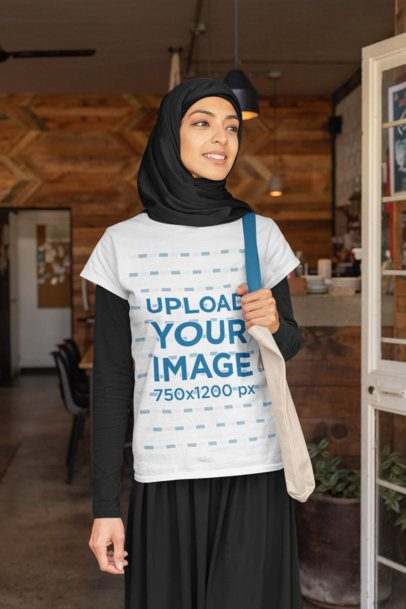 T-Shirt Mockup of a Woman with a Hijab Holding Her Purse 32407