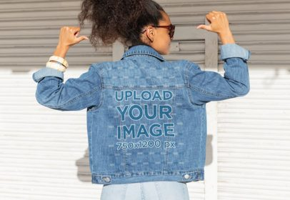 Mockup of a Woman Pointing at Her Denim Jacket 32555