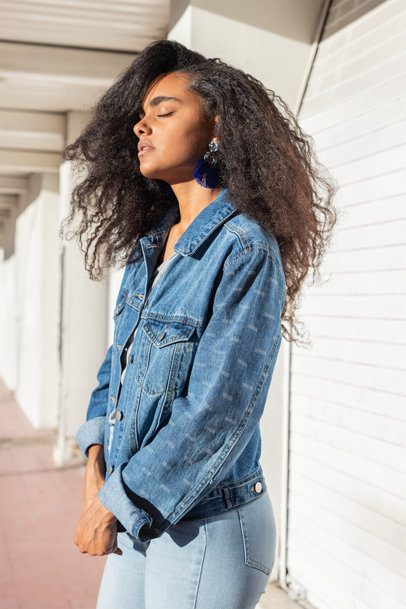 Mockup Featuring a Young Woman Wearing a Denim Jacket with a Customizable Sleeve 32558
