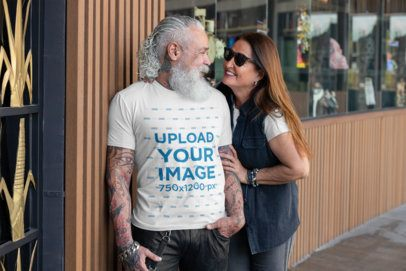 T-Shirt Mockup Featuring a Senior Man with a Cool Beard Talking to His Wife 32851
