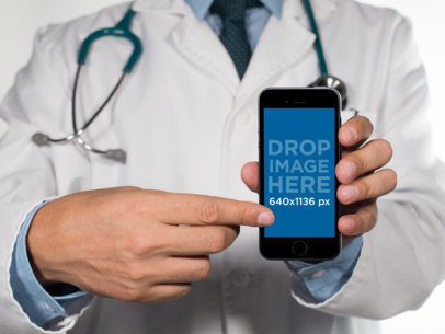 iPhone Mockup of a Doctor Pointing to an iPhone 6 in Frontal View a12404