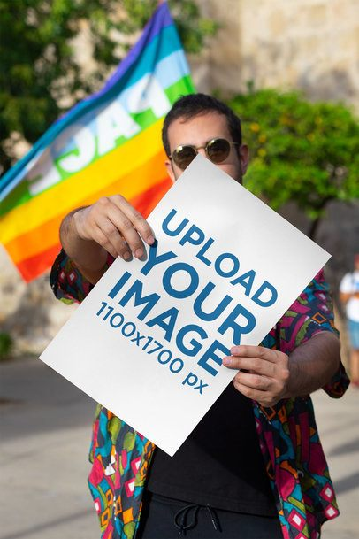 Mockup Featuring a Man Showing a Poster at the Pride Parade 32973