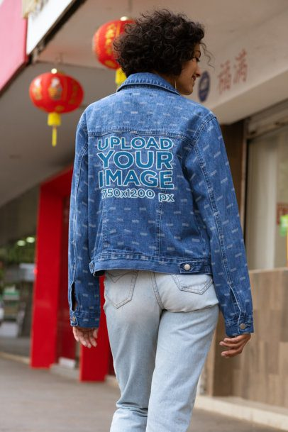 Back View Mockup of a Woman with a Denim Jacket Posing by a Chinese Restaurant 32576