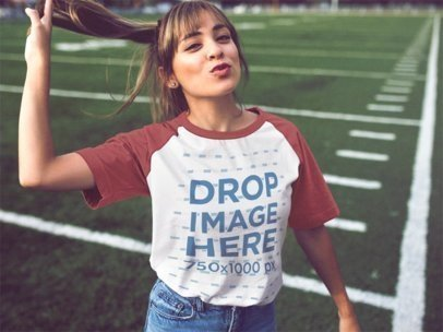 Flirty Young Girl Wearing a Raglan Tee at a Football Field a12476a