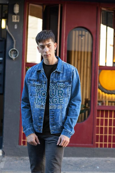 Denim Jacket Mockup Featuring a Serious Man at a Street 32595
