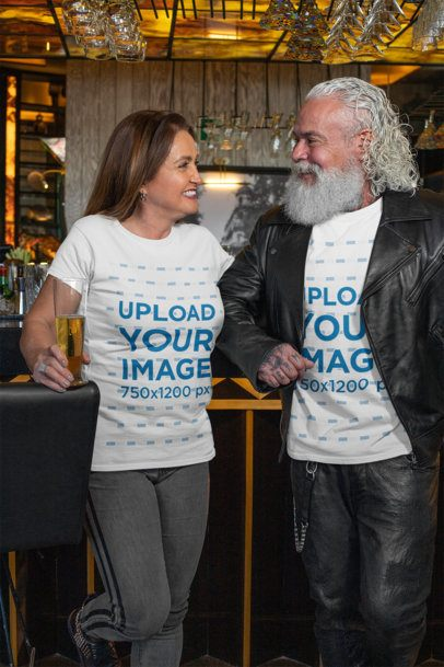 T-Shirt Mockup Featuring a Tattooed Senior Man and a Woman at a Bar 32870