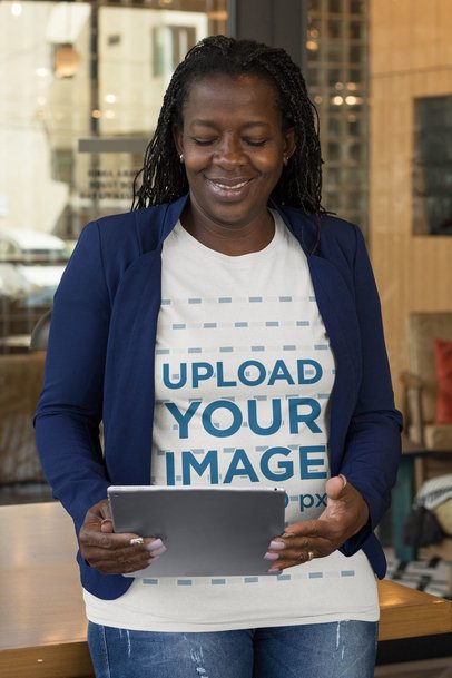 T-Shirt Mockup Featuring a Senior Woman Looking at Her Tablet 32895
