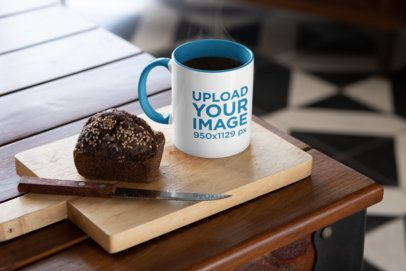 Mockup Featuring an 11 oz Colored Rim Mug Placed Next to a Muffin 33190