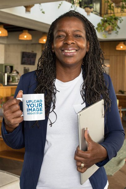 Mockup of a Middle-Aged Woman Holding an 11 oz Coffee Mug at a Coworking Space 32904