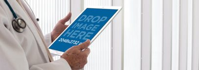 iPad Mockup of a Senior Doctor Holding his iPad Pro a12441wide