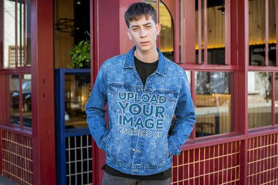 Sublimated Denim Jacket Mockup Featuring a Man by a Restaurant 32611