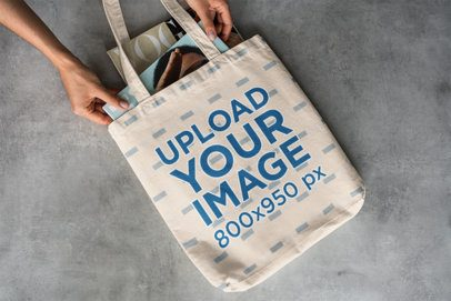 Mockup of a Woman Holding a Tote Bag With Things in It 3146-el1