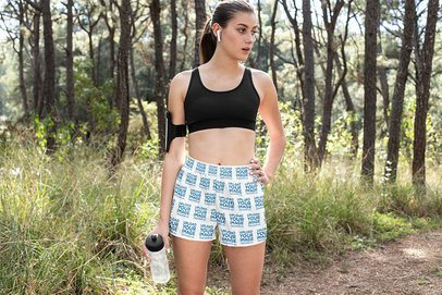 Sublimated Shorts Mockup Featuring a Woman Training in the Woods 33065