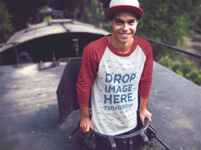 Raglan T-Shirt Mockup of a Young Man Peeking out of a Train b12513