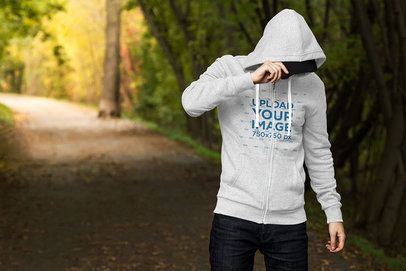 Mockup of a Man Wearing a Heathered Full-Zip Hoodie in the Woods 3571-el1