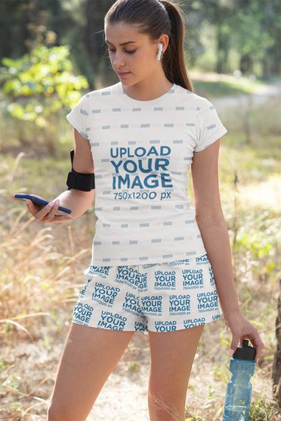 Mockup of a Young Woman Wearing a Sublimated T-Shirt and Shorts 33079