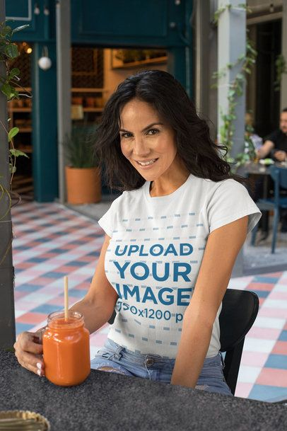 T-Shirt Mockup Featuring a Woman Drinking a Healthy Juice 32771