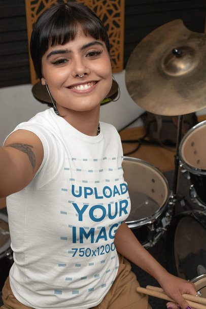 Mockup Featuring a Female Drummer Wearing a Customizable T-Shirt and Taking a Selfie 33341