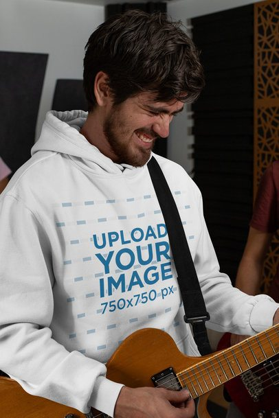 Pullover Hoodie Mockup of a Bearded Man Playing the Guitar 33340