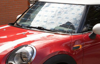 Mockup of a Decal on the Window of a Red Compact Car 33252