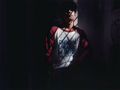 Raglan Tee Mockup of a Young Man Sitting in a Dark Room a12516a