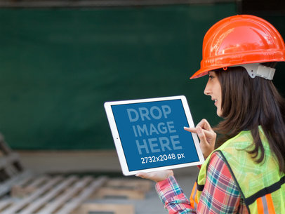 iPad Mockup in Landscape Position of a Female Worker Outside a Construction 12569b