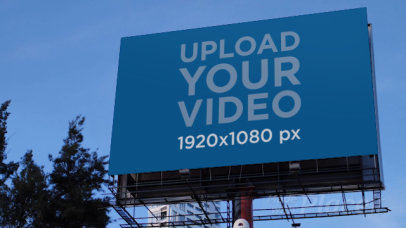 Video of a Billboard Against a Clear Blue Sky 32971