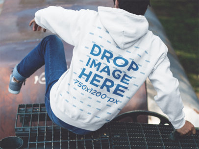 Back Side Hoodie Mockup of a Guy Jumping Off a Train a12498