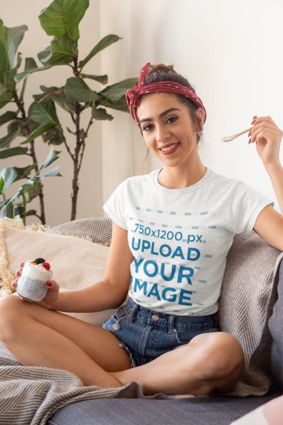 Mockup of a Woman Wearing a T-Shirt While Eating a Healthy Breakfast -32749