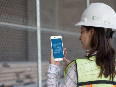iPhone Mockup in Portrait Position of a Female Operator with Blurry Background 12575b
