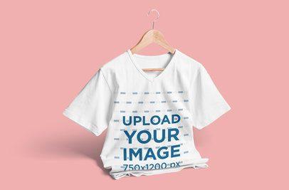 V-Neck T-Shirt Mockup Featuring a Clothing Hanger and a Solid Color Backdrop 3674-el1