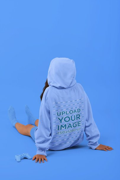 Back-View Mockup of a Woman with a Sweatshirt Sitting on a Studio's Floor 32816