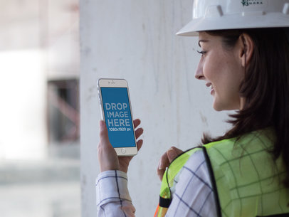 iPhone Mockup in Portrait Position of a Woman Architect at the Site a12579