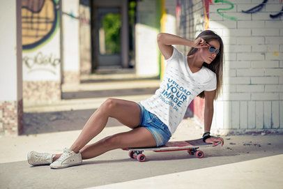 T-Shirt Mockup of a Cool Young Woman Sitting on a Board 3686-el1