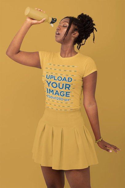 Monochromatic T-Shirt Mockup of a Stylish Woman Drinking Water at a Studio 32794
