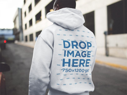 Back Side Hoodie Mockup of a Man Walking Down a Street b12553