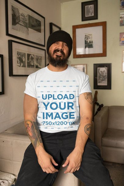 Mockup of a Bearded Man with Tattoos Wearing a T-Shirt Indoors 32838