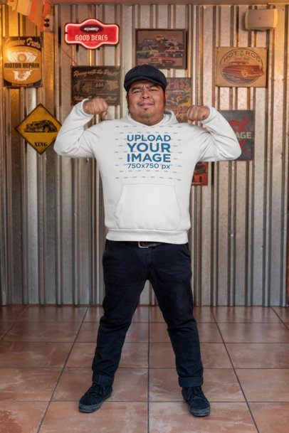 Hoodie Mockup of a Man Doing a Strong Pose at a Bar 32862