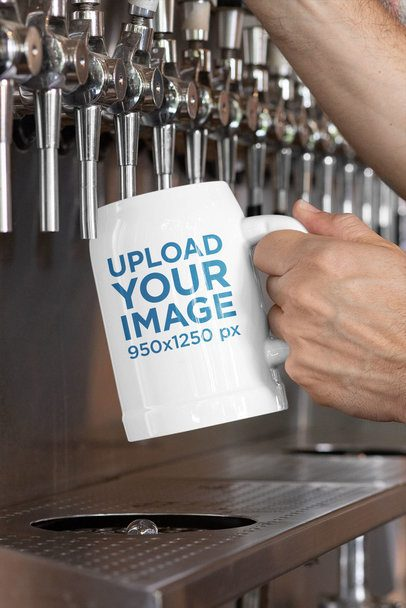 Beer Mug Mockup of a Man Pouring Liquid Into It 33424