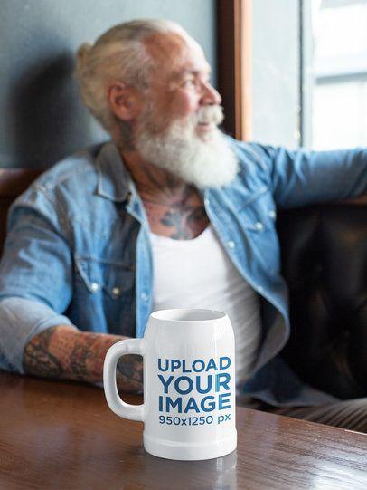 Beer Mug Mockup Featuring a Bearded Man Relaxing at a Bar 33442