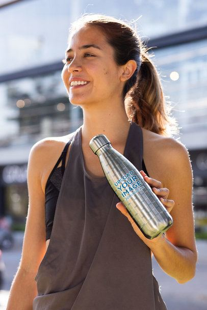 Mockup of a Woman Showing Her Aluminum Bottle 33516