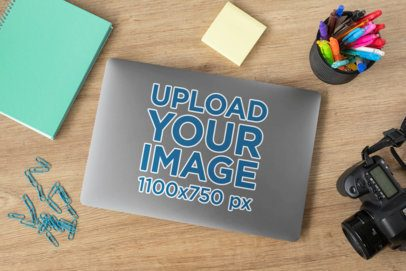 Mockup of a Sticker on a Laptop Placed Next to Some Stationery Items 33603