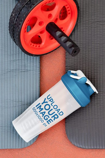Mockup of a Blender Bottle Placed Next to an Ab Wheel 33678