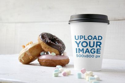 Mockup of a Paper Cup Next to Some Donuts 3780-el1