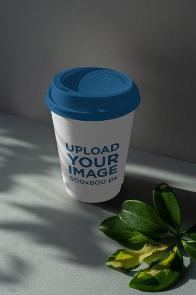 Mockup of a Paper Cup Featuring Some Leaves Shadows 3765-el1